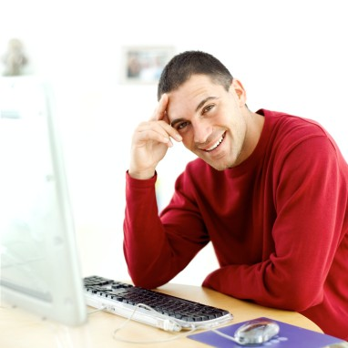 Young Man Sitting at a Computer