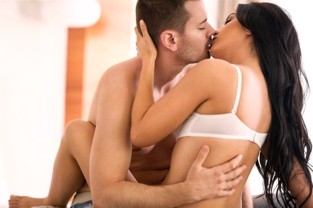 attractive couple in passion embrace kissing
