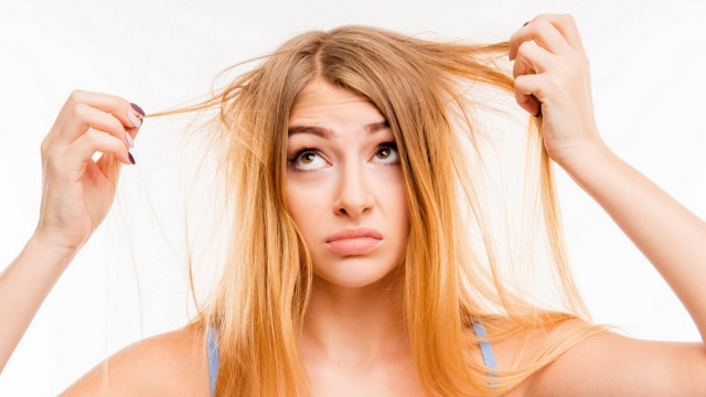 Sad girl looking at her damaged hair; Shutterstock ID 364442840; PO: today.com