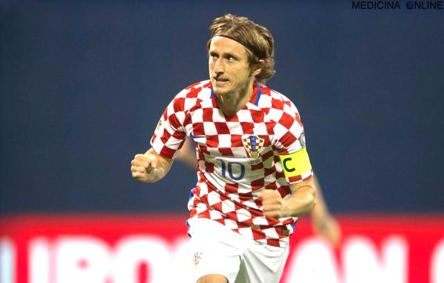 MEDICINA ONLINE Luka Modrić  calciatore croato centrocampista del Real Madrid nazionale croata capitano WORL CUP FIFA SOCCER FOOTBALL FINAL FINALE NON MOLLARE GUERRA CALCIO SPORT.jpg