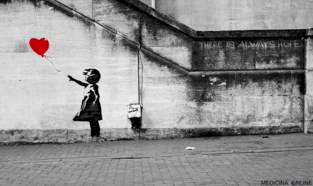 MEDICINA ONLINE artista di strada Banksy girl love ballon heart graffiti muri murales bambina palloncino cuore amore poesia non corrisposto gioco di sguardi innamorati coppia fidanzati matrimoni sposati divorzio separazione.jpg